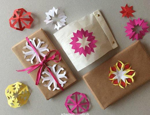 Scherenschnitte als Deko für Geschenke und Festtisch